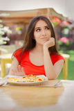 Young Woman Refusing  To Eat a Pizza Royalty Free Stock Photos
