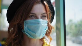 Young woman rejoices at lifting of quarantine and taking off her medical mask to protect against virus and infection