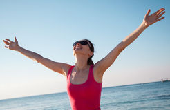 Young woman rejoices at summer vacation Royalty Free Stock Image