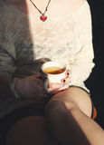 Young woman relax with cup of tea Royalty Free Stock Image