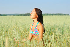 Young woman relax on the green field Stock Images