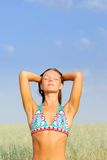 Young woman relax on  green field Stock Photo