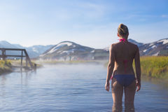 Young woman relax in a hot spring  Iceland. Girl enjoying bathing in a hot water Stock Photography