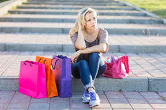 Young woman relax on stairs after shopping Royalty Free Stock Images