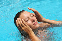 Young woman relax in the swimming pool Royalty Free Stock Photos