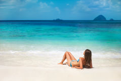 Young woman relax on the tropical beach Stock Images