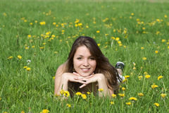 Young woman relaxation. And lying on grass royalty free stock photography
