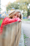 Young woman relaxation leaning on a fence Royalty Free Stock Photo