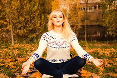 Young woman during relaxation and meditation in park stock photography
