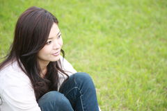 Young woman relaxed on a lawn Stock Photography