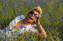 Young woman relaxes on meadow Stock Photography