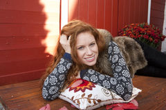 Young woman relaxes on a pillow Royalty Free Stock Photo