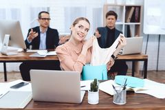 Young woman relaxes at work. She looks at the purchases. royalty free stock photo