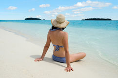 Young woman relaxing on Aitutaki Lagoon Cook Islands Stock Photo
