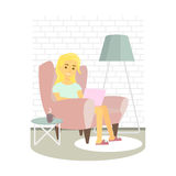 Young woman relaxing on armchair and browsing Internet . Girl with laptop at home. Vector illustration. Stock Image