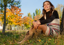 Young woman relaxing in the autumn park stock images