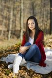 Young woman relaxing in the autumn park Royalty Free Stock Photography