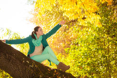 Young woman relaxing in autumnal park. Royalty Free Stock Images