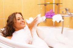 Young woman relaxing in a bath Royalty Free Stock Photos