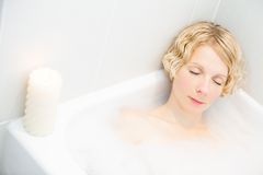 Young woman relaxing in the bath Royalty Free Stock Image