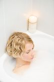 Young woman relaxing in the bath Stock Photo