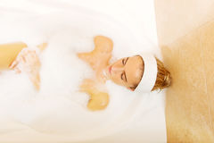 Young woman relaxing in bath Royalty Free Stock Image
