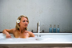 Young woman relaxing in bathroom Stock Image