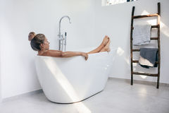 Young woman relaxing in bathtub Stock Photos