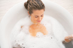 Young woman relaxing in bathtub Royalty Free Stock Photo