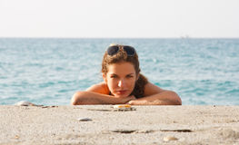 Young woman relaxing on beach. Young woman relaxing on the beach Royalty Free Stock Photography