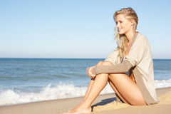 Young Woman Relaxing On Beach. Smiling Royalty Free Stock Photos