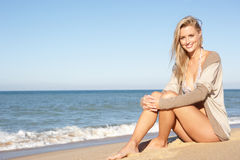 Young Woman Relaxing On Beach Royalty Free Stock Images