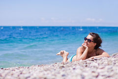 Young woman relaxing on the beach. Woman relaxing on the beach Royalty Free Stock Photography