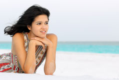 Young Woman Relaxing on a Beach Stock Photography