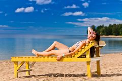 Young woman relaxing on beach Royalty Free Stock Photography