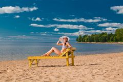 Young woman relaxing on beach Stock Photo