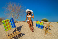 Young woman relaxing on beach Stock Photography