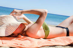 Young woman relaxing on the beach Royalty Free Stock Image