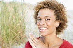 Young woman relaxing at beach Stock Photos