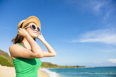 Young  woman relaxing on the beach Stock Photos