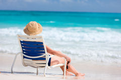 Young woman relaxing at beach Stock Photo