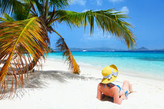 Young woman relaxing at beach Stock Photos
