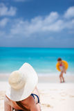 Young woman relaxing on beach Royalty Free Stock Photo