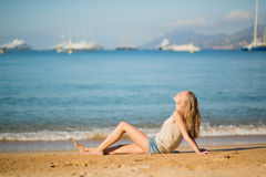 Young woman relaxing on the beach Stock Images