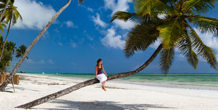 Young woman relaxing at beach Royalty Free Stock Images