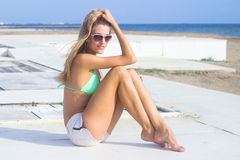 Young woman relaxing on beach Stock Photos