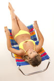 Young woman relaxing in beach chair Stock Photos