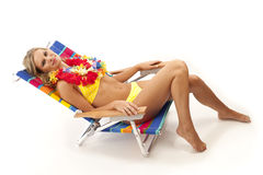Young woman relaxing in beach chair Stock Images
