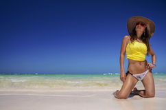 Young woman relaxing on beach and enjoying the nice weather Royalty Free Stock Photography