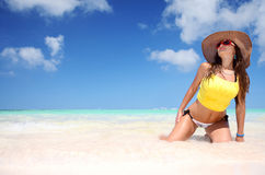 Young woman relaxing on beach and enjoying the nice weather Stock Photos